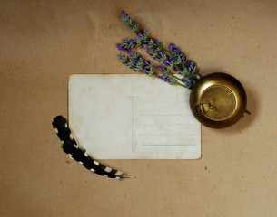 Vintage old postcard, snuffbox, lavender and feathers