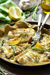Baked cod with ginger,lemon and rosemary.