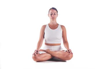 "Woman practicing the ""Lotus Pose"" yoga posture"
