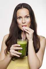 Portrait of a Woman Drinking Green Fruit Juice