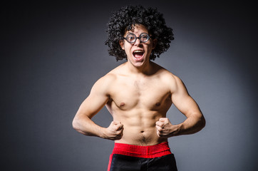 Funny sportsman sporting his muscles