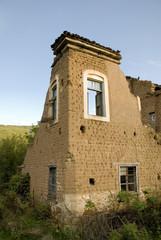 Distinguished details from a half demolished brick house