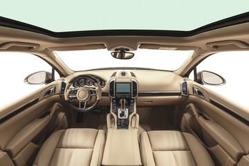 Interior of prestige modern car. Beige cockpit