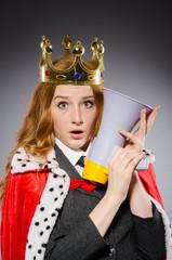 Queen businessman with loudspeaker in funny concept