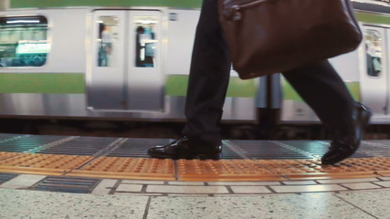 Business men walk in the subway in slow motion