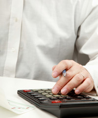 young man calculating bills at home