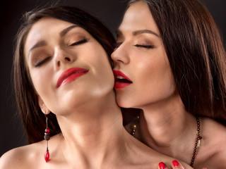 Two sexy lesbian women kissing.
