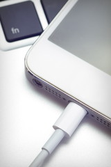 Close - up Phone charging from computer notebook
