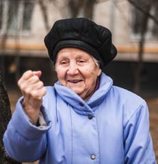 portrait  senior mature woman  putting up fist
