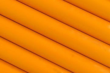 Orange plastic tubing pattern texture background
