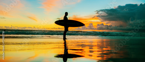 Surfer with board - 72483718