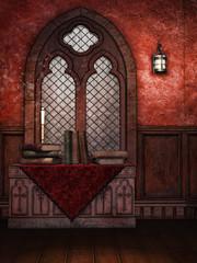 Stół ze starymi księgami na tle okna