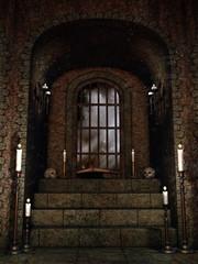 Okno w starej krypcie z czaszkami, świecami i księgami