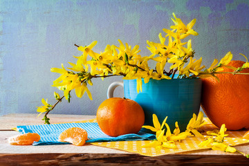 Still life spring bouquet yellow forsythia oranges