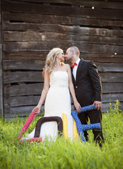 Bride and groom having fun outside