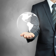 Businessman hand carrying the globe