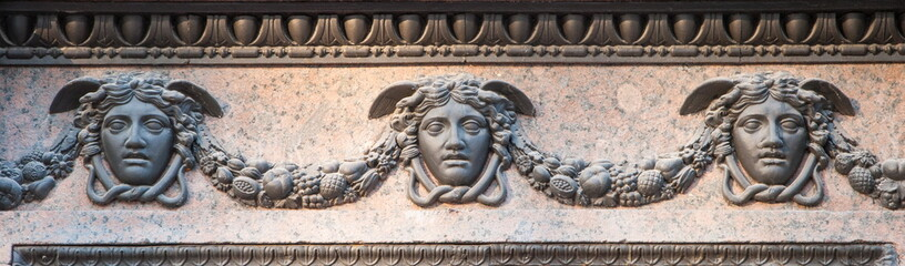 bas-relief depicting  masks of Hermes (Mercury)