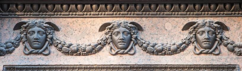 bas-relief depicting  masks of Hermes (Mercury)