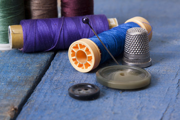 sewing threads isolated on the blue wooden