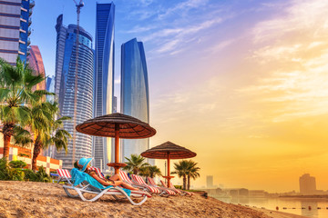 Sun holidays on the beach of Persian Gulf at sunrise