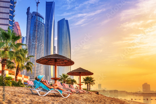 Sun holidays on the beach of Persian Gulf at sunrise - 72492996