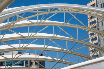 White Curved Tubular Steel Architecture Under Blue Sky