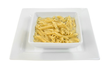 Square bowl of pasta on square plate