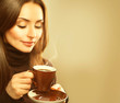 Coffee. Beauty Model Woman with the Cup of Hot Drink