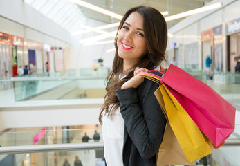 young beautiful woman in a shopping center