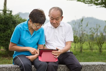 Senior couple on computer tablet