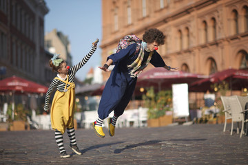 Street performance of clowns, learning to fly
