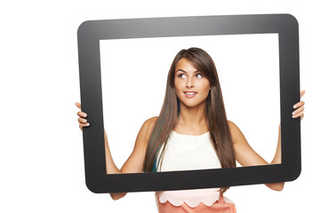 Woman looking to side through tablet frame