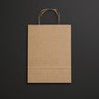 Brown paper bag with handles on black background - 72498568
