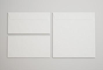 White envelopes on light gray background
