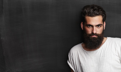 Portrait of a bearded man on chalkboard background