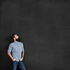 Bearded man looking at chalkboard