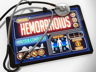Hemorrhoids on the Display of Medical Tablet.