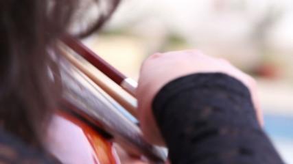 musician play on violin
