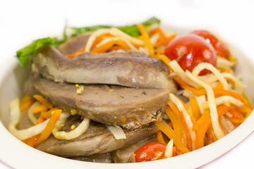 Braised lamb tongues with pasta and vegetables