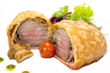 beef in pastry with salad on the table in a restaurant