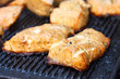 Salmon grilling on cast iron grill. Out of focus background.