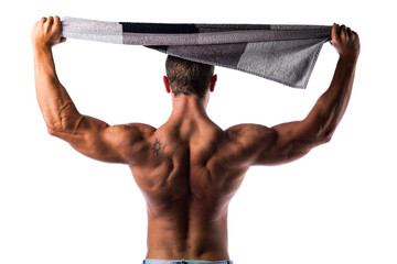 Back of shirtless muscular hunk holding towel above his head
