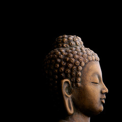Profile of Buddha  isolated on black background