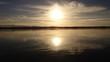 canvas print picture - Die Sonne geht am See unter