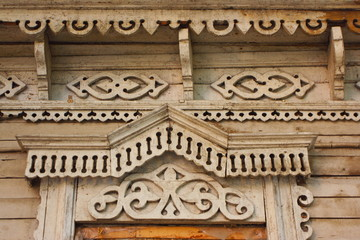 Traditional wooden Russian carved platband of an old house