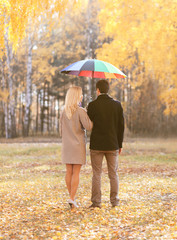 Autumn, love, relationships and people concept - young couple in