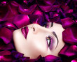 High fashion vogue style model portrait with rose petals