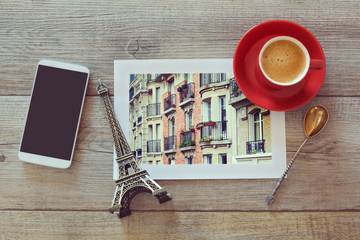Photo of buildings in Paris with coffee and smart phone.