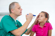 Постер, плакат: Eye doctor examining young girl patient Ophthalmology