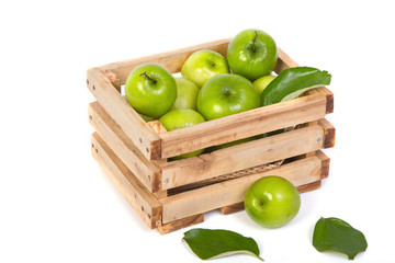Green Monkey apple or jujubes in wooden crate